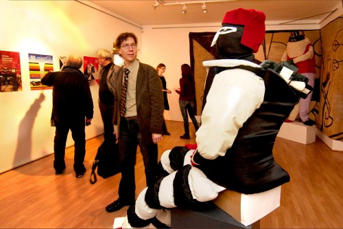 Opening of the exhibition of costumes for Victory over the Sun by Galina Gubanova (Kerri Kotta looking at a costume of the Futurist Strongman). Photographer: Harri Rospu.